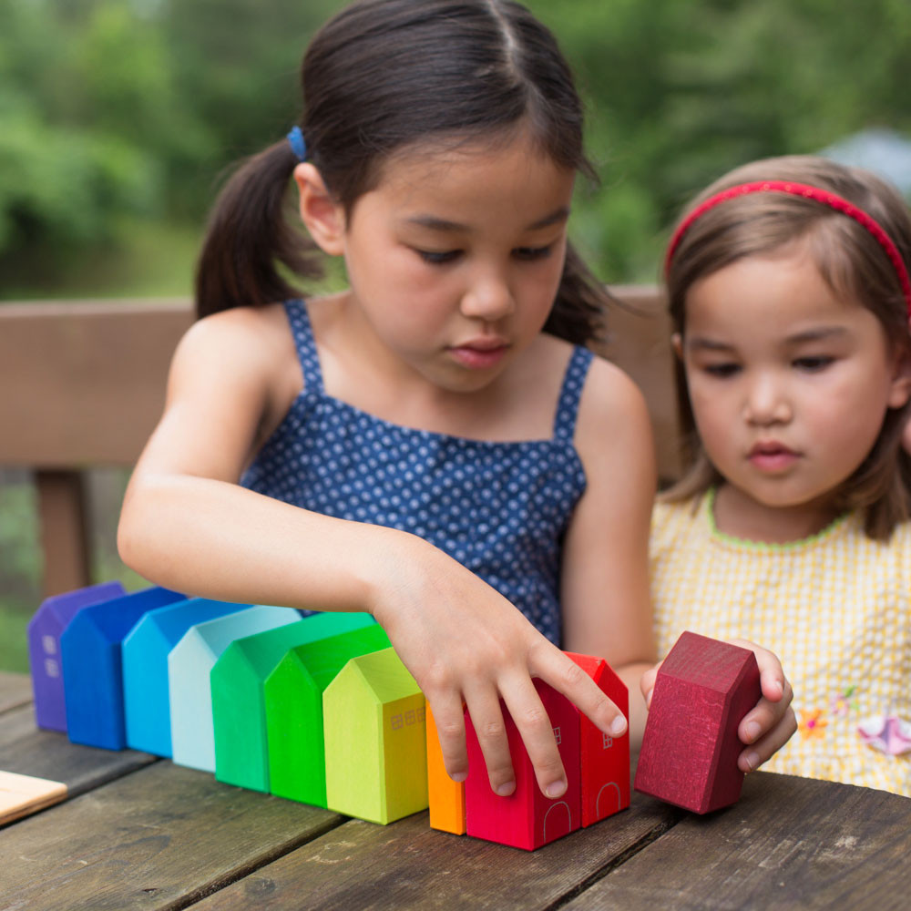 Two girls playing with Nova Natural building blocks.