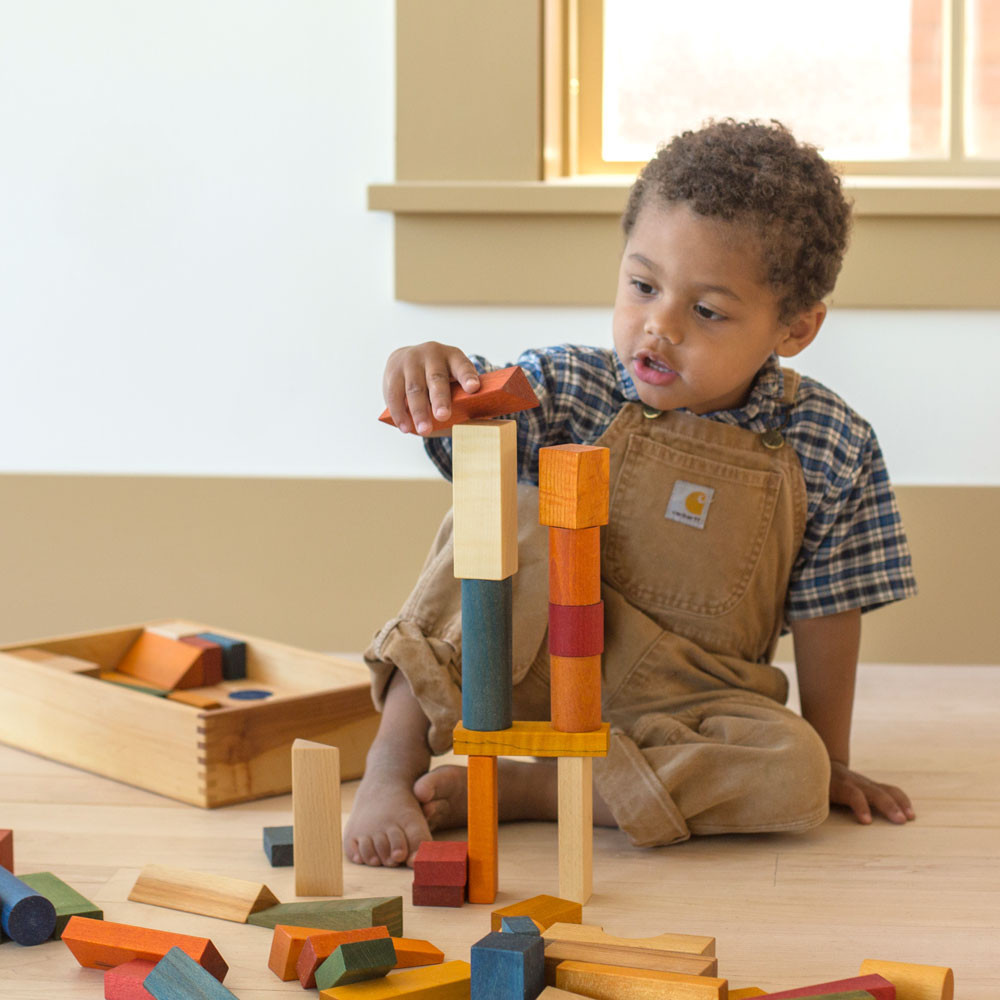 Child Playing with Nova Natural Blocks in a Box